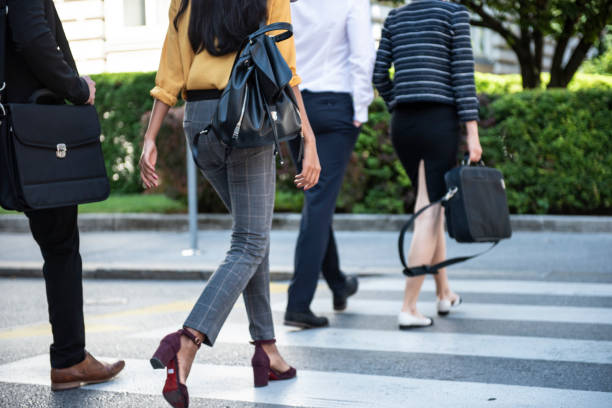 Business people crossing the city street