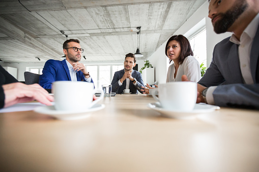 Business People Discussing About Project In Boardroom Stock Photo - Download Image Now