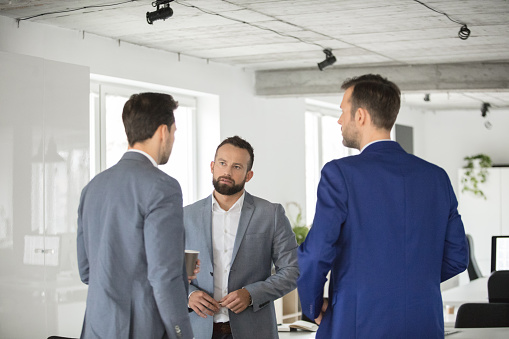 Business People Discussing At Coffee Break Stock Photo - Download Image Now