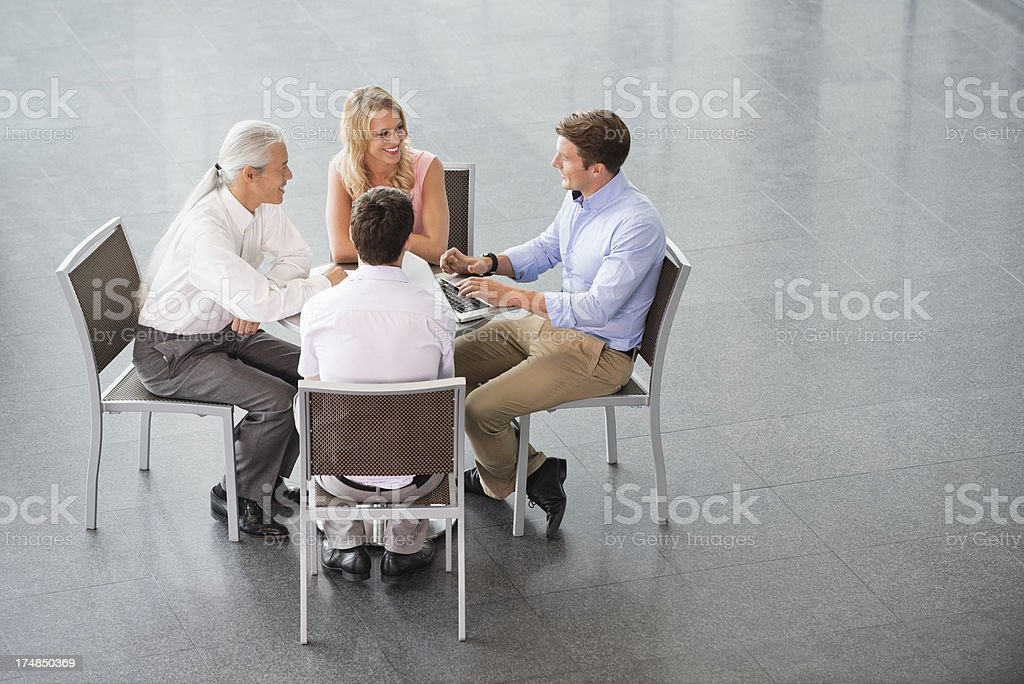 Business People Discussing At Table royalty-free stock photo
