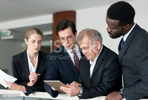 istock business people discussing business strategy using digital tabletusing digital tablet 922650474