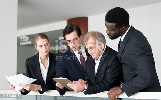 istock Business people discussing business strategy using digital tablet 923206316