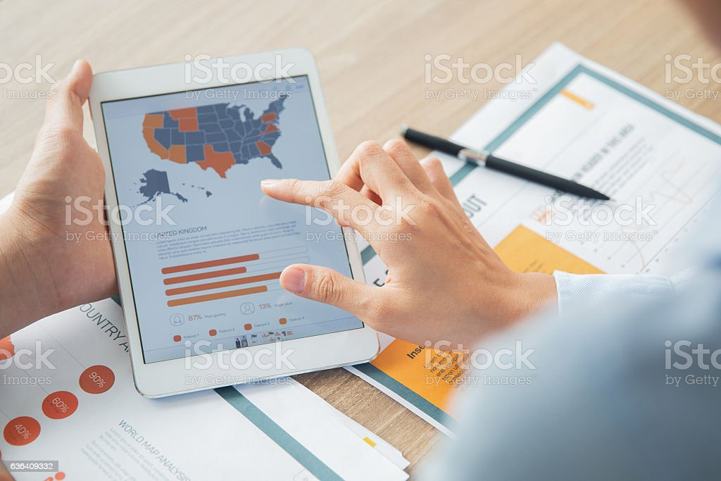 Business people discussing chart on digital tablet stock photo
