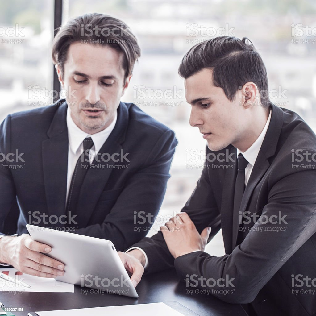 Business people discussing charts royalty-free stock photo