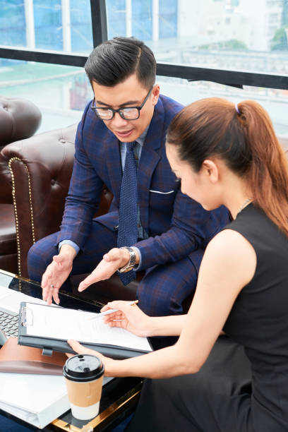 Business people discussing document stock photo