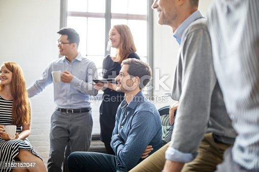 1150572092istockphoto Business people discussing during a coffee break 1152152047