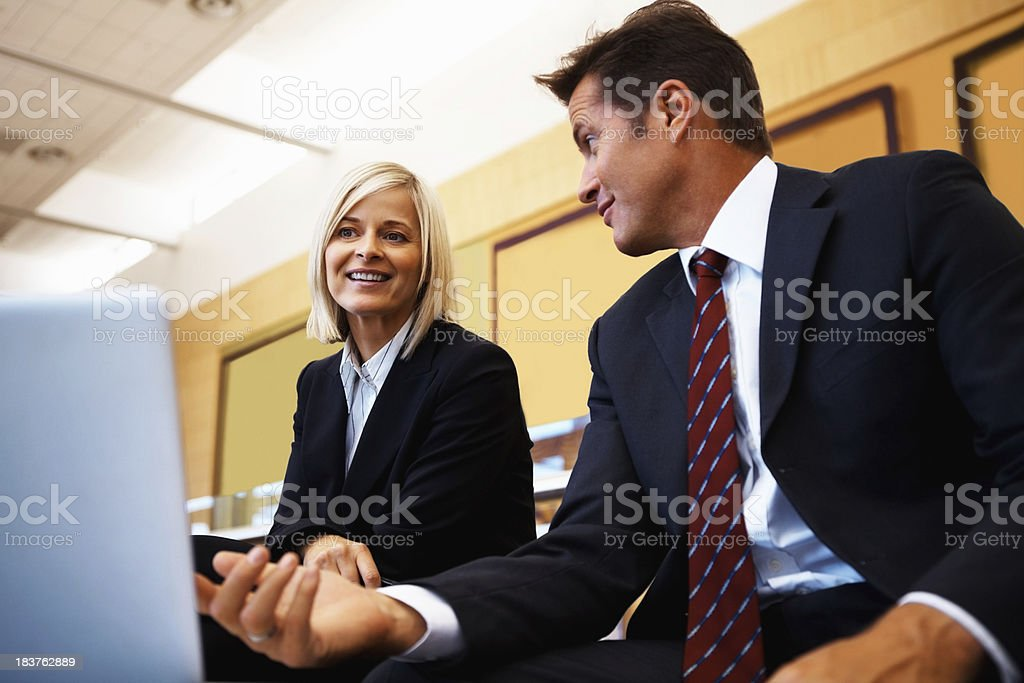 Business people discussing ideas on laptop royalty-free stock photo