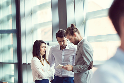 Business People Discussing In An Office Stock Photo - Download Image Now