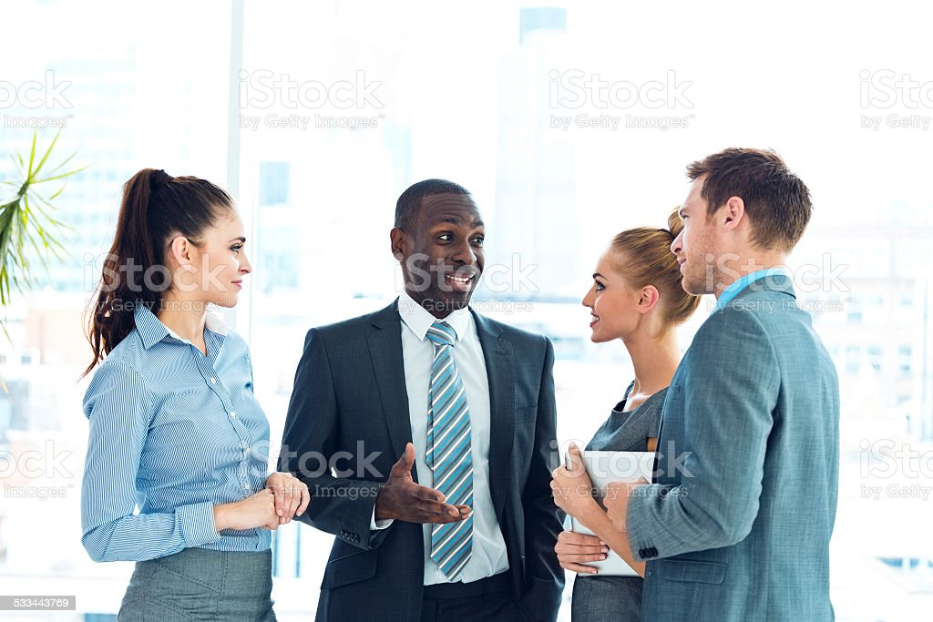 Business people discussing in an office stock photo