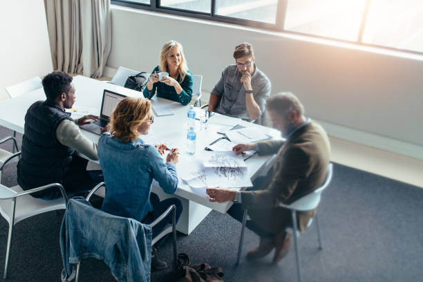 business people discussing in meeting at office - civil engineer stock photos and pictures