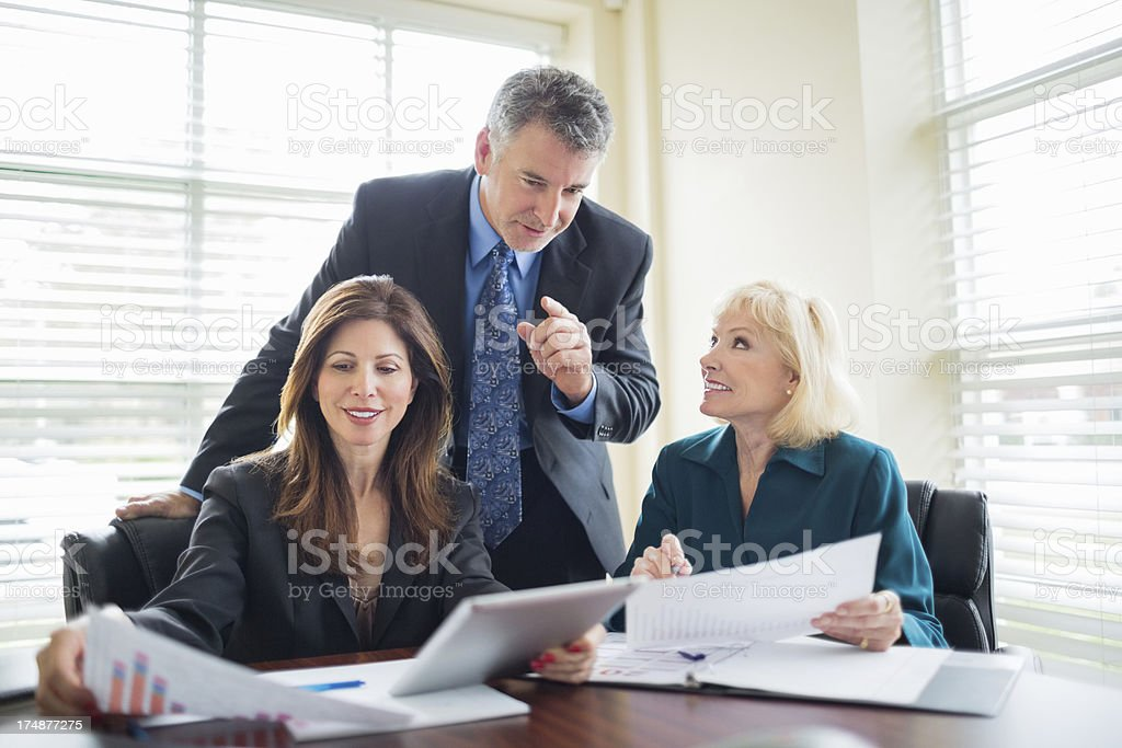 Business People Discussing In Meeting Room royalty-free stock photo