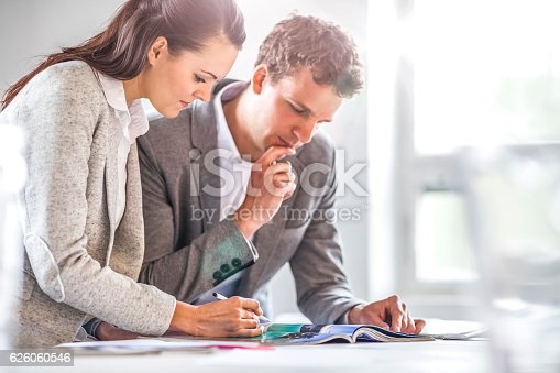 496441730 istock photo Business people discussing in office 626060546