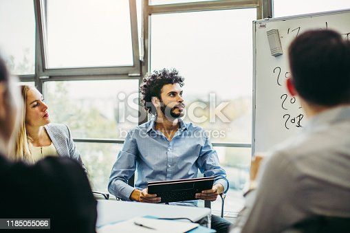 Business people working in the board room