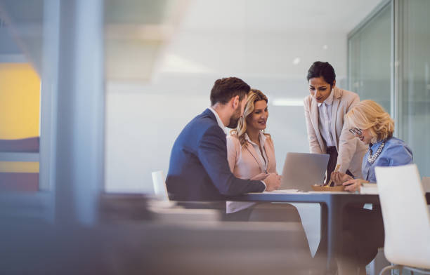 Business People Discussing in The Office stock photo