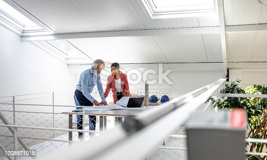 496441730 istock photo Business people discussing in the office 1208571015