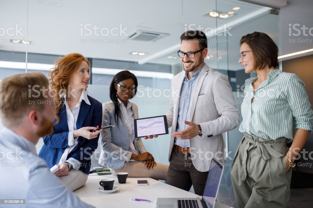 Business people discussing new market and sales analysis stock photo