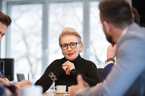 Business People Discussing New Project In Meeting Stock Photo - Download Image Now