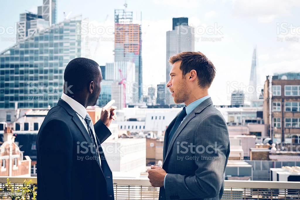 Business people discussing outdoor stock photo