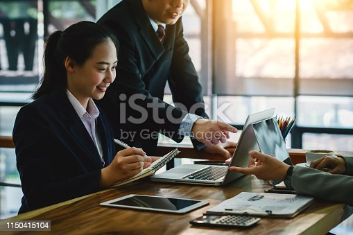 istock Business people discussing project in laptop and financial planning concept. 1150415104