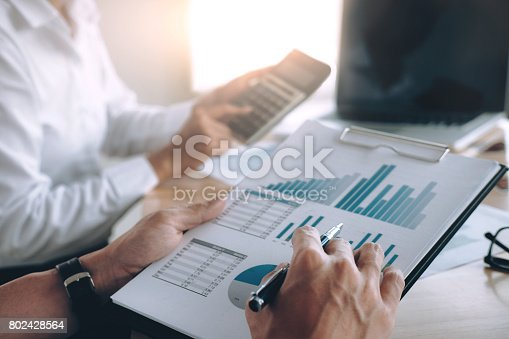 954578184 istock photo Business people discussing results of successful teamwork. 802428564