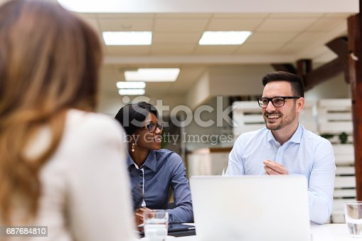 687687166 istock photo Business people discussing strategy with a financial analyst 687684810