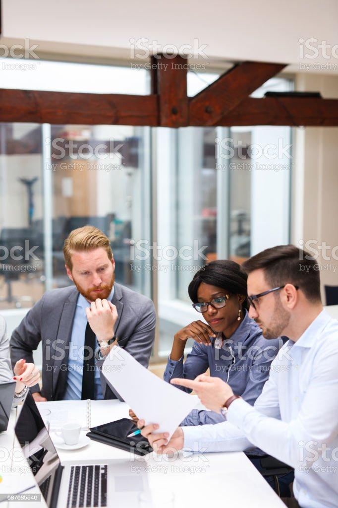 Business people discussing strategy with a financial analyst stock photo