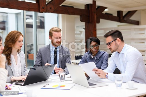 687687166 istock photo Business people discussing strategy with a financial analyst 687687166
