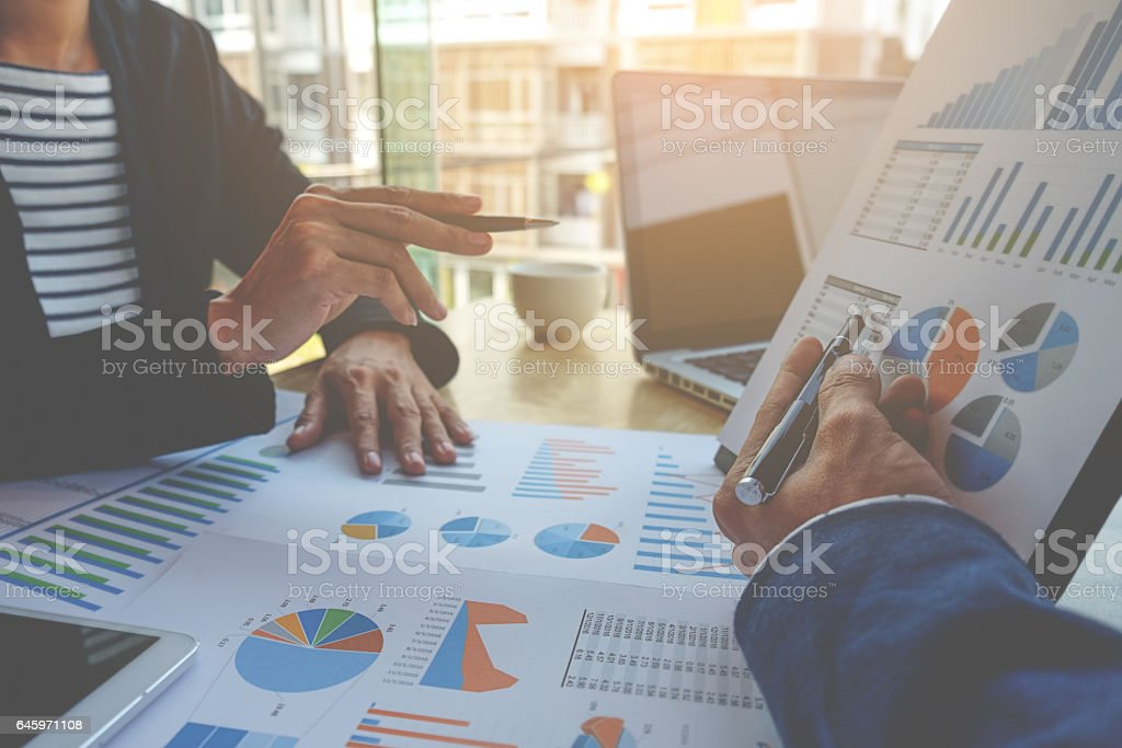 Business people discussing the charts and graphs stock photo