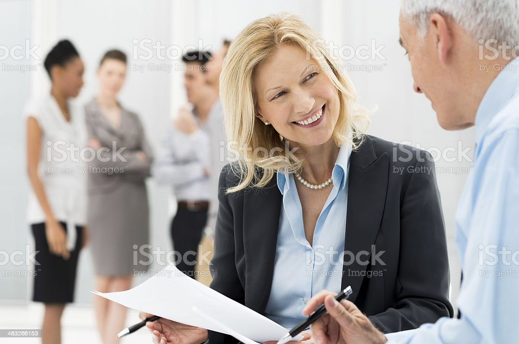 Business People Discussing Together stock photo