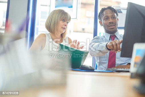 istock Business people discussing work on computer 874291028