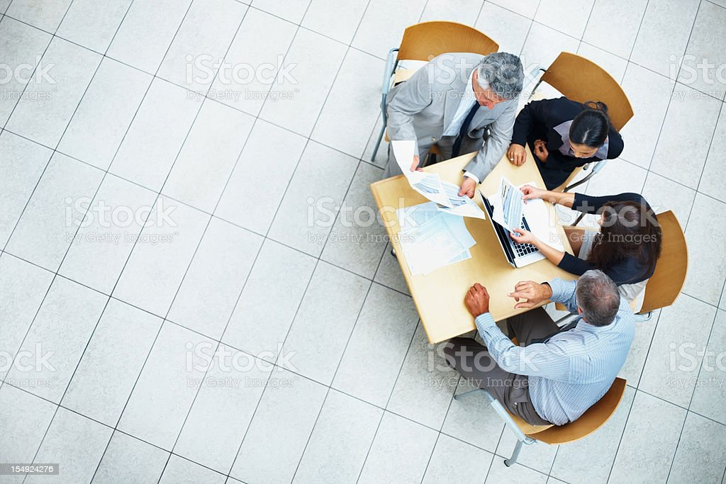 Business people discussing work on laptop royalty-free stock photo