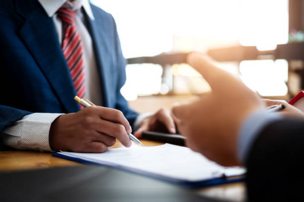 Business people discussion and negotiating investment housing estate with sign a contract term loan facility in office. contract and agreement concept. stock photo