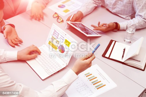 954578184 istock photo Business People discussion at Table using variety of electronic Devices 543817436
