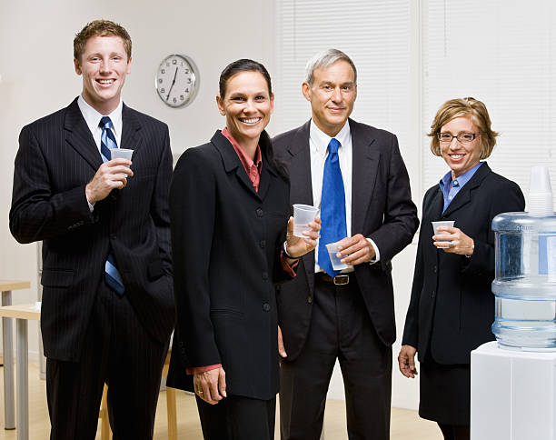 Business People Drinking at Water Cooler stock photo
