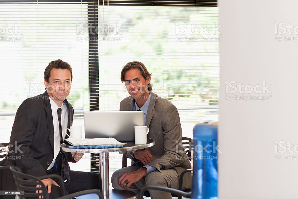 Business people drinking coffee at laptop royalty-free stock photo