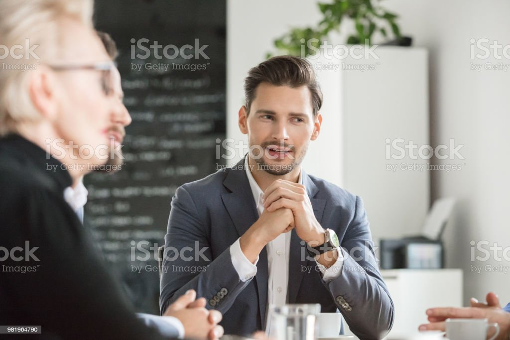 Business people during a meeting Young businessman in discussing with colleagues in meeting. Business people discussing over new plan in office. Active Seniors Stock Photo