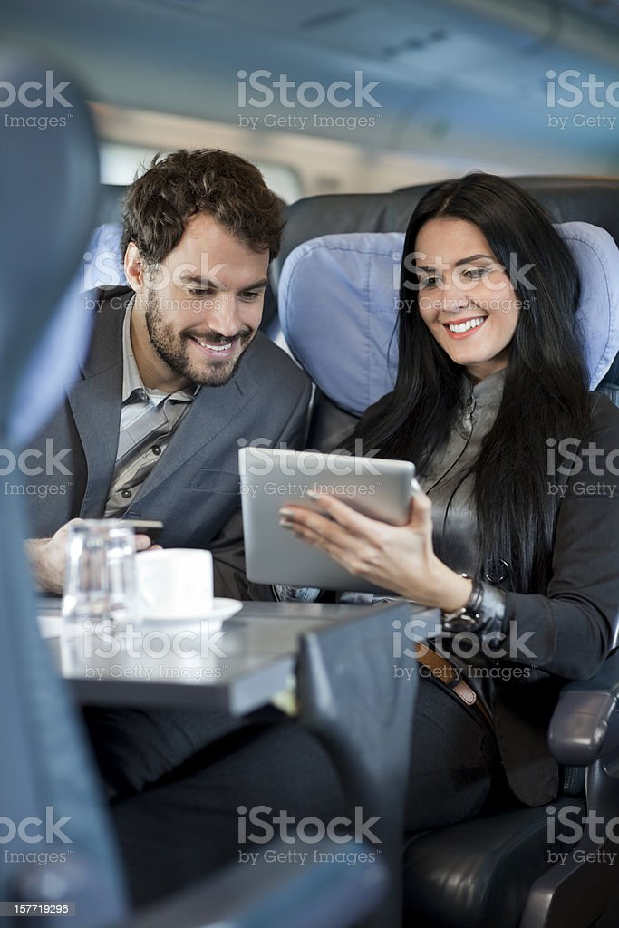 Business people during a train journey, working royalty-free stock photo