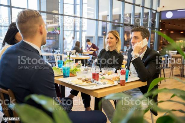 Business people during lunch picture id658439578?b=1&k=6&m=658439578&s=612x612&h= atwxap2vzijrxbbn5jkiugww59rsw9hnrnq8pjvb40=