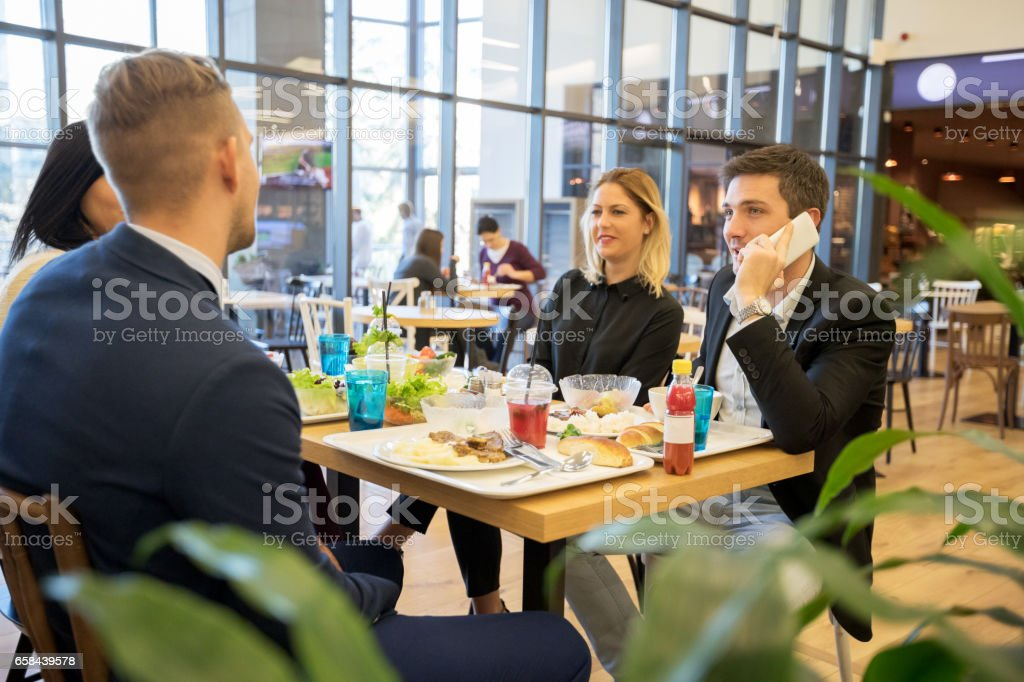 Business people during lunch stock photo
