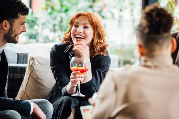 business people enjoying after work drinks - happy hour stock photos and pictures