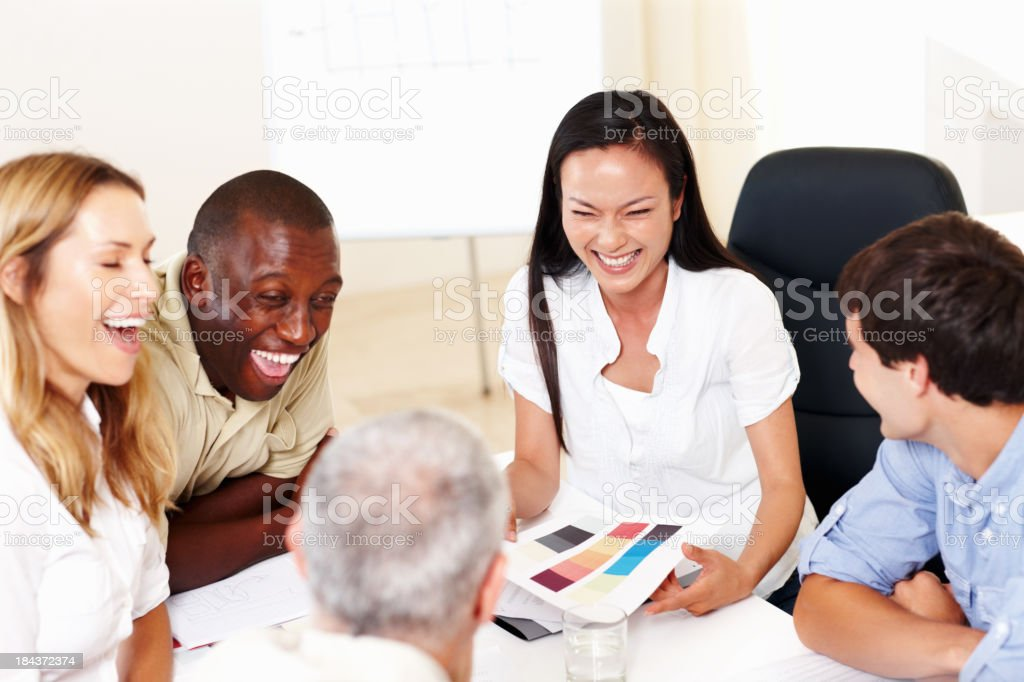 Business people enjoying conversation about color samples royalty-free stock photo