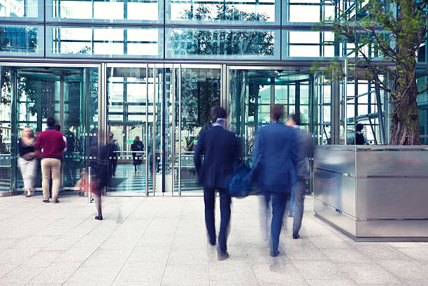 Business People Entering and Leaving Office Building, Motion Blur stock photo