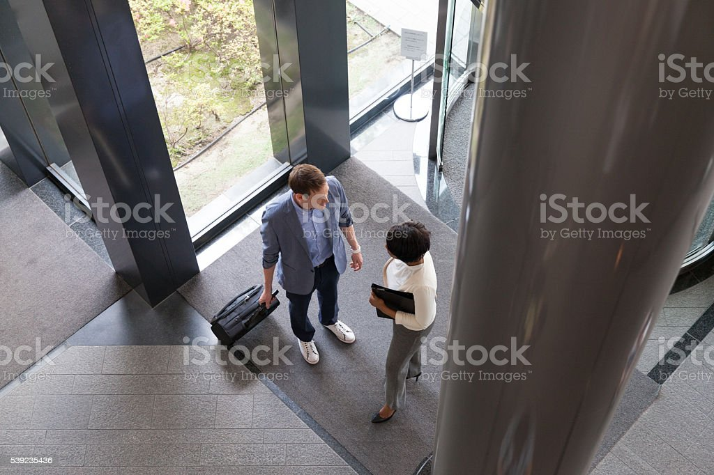 business people entering into the lobby royalty-free stock photo