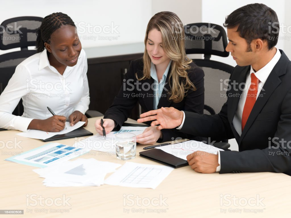 Business people examining graphs royalty-free stock photo