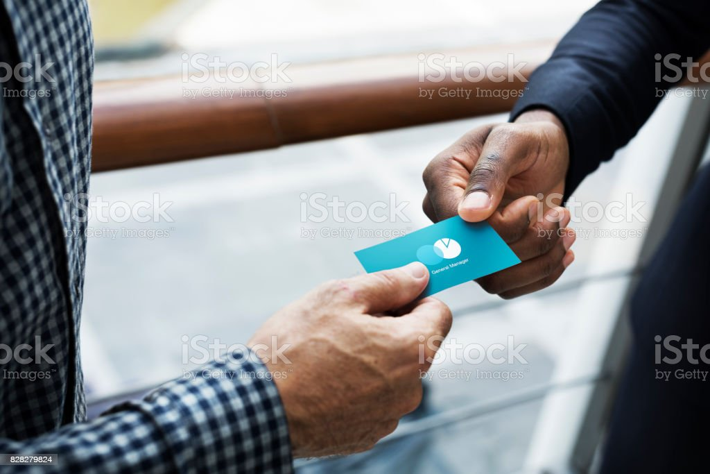 Business people exchanging a business card stock photo