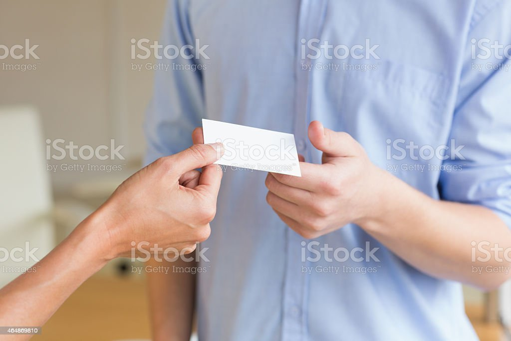 Business people exchanging visiting cards stock photo