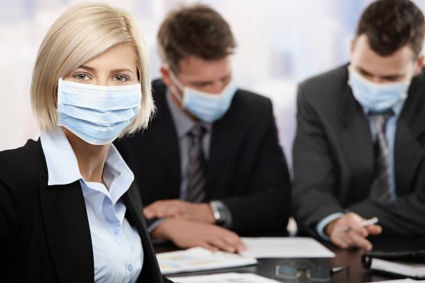 Business people fearing swineflu virus stock photo
