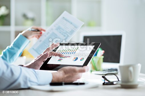 istock Business people filling out tax form 1040 in office 513810600