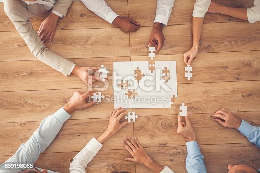 istock Business people finding solution together at office 639198068