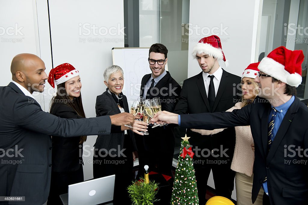 Business people for Christmas at the office stock photo